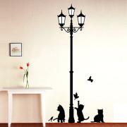 kissat katulampun alla seinätarra