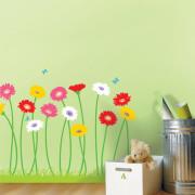 maasta kasvavia kukkia seinätarra